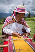 Quechua woman weaving cloth in Misminay Village, Sacred Valley, Peru.