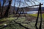Monticchio Laghi (PZ) 12.03.2011 - Il degrado dei laghi di Monticchio (PZ). Una delle spiaggette del lago grande invasa dall'acqua con rifiuti che vi galleggiano e i giochi per i bambini abbandonati.