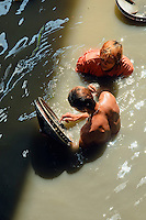 Panning for coins in the Chao Phraya river, Bangkok Thailand
