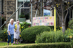 "© Licensed to London News Pictures. 04/08/2019. Whaley Bridge, UK. A placard reading "" Thank you for all your help!"" is tied up outside a house by residents living just outside the cordon , in thanks to emergency services . Further homes have been evacuated overnight and more rain is forecast today (Sunday 4th August) in the town of Whaley Bridge in Derbyshire after earlier heavy rain caused damage to the Toddbrook Reservoir , threatening homes and businesses with flooding. Photo credit: Joel Goodman/LNP"