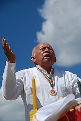 "Mexico, Yucatan, Mayapan, October 17, 2010. Mayan high priest Ildelfonso Ake Cocom conducts a ""saka"" purification ceremony on the grounds of Mayapan, a ruined Yucatecan capital city dating from the period between 1220 and 1240 AD. Photographs commissioned by SECTUR. More at MexicoCulturalCalendar.com"