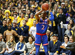 Jan 15, 2018; Morgantown, WV, USA; Kansas Jayhawks guard Lagerald Vick (2) shoots a three pointer during the first half against the West Virginia Mountaineers at WVU Coliseum. Mandatory Credit: Ben Queen-USA TODAY Sports