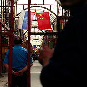 Russian and Chinese flags hang at the Cherkizovo market in eastern Moscow, which was rocked by .an explosion that killed 10 people, including two children, and injuring more than 40..Prosecutors said the attack was likely linked to organized crime, though terrorism could not be ruled out. The market is crowded with Chinese and Muslim merchants..The explosion crashed the roof of around 100 sq meters and triggering the fire.