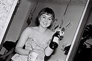 A girl celebrates, Northolt, UK, 1987.