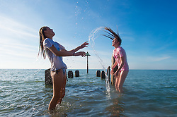 © London News Pictures. 29/08/2016. Aberystwyth, UK<br /> Teenage girls having fun on the last week of the long summer holidays, swimming and  jumping into the sea on a fine August Bank Holiday Monday of warm sunshine and blue skies in Aberystwyth on the Cardigan Bay coast, west Wales, UK. Photo credit: Keith Morris/LNP