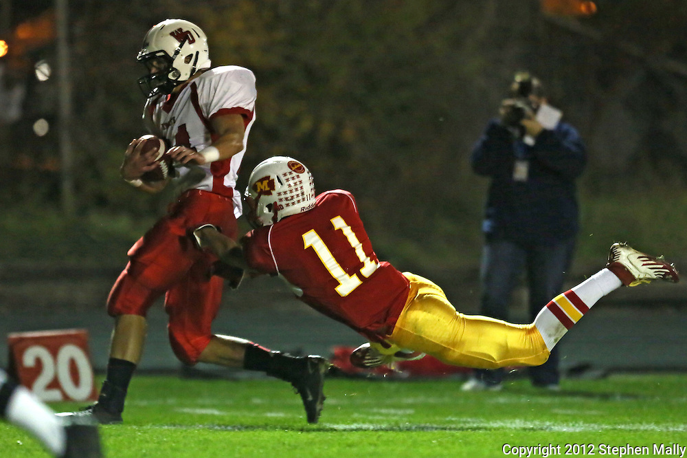 Marion's Quinn Cannoy (11) can't pull down Western Dubuque's Dylan James (24) on a touchdown reception during their first round playoff game at Thomas Park Field in Marion on Wednesday, October 24, 2012.