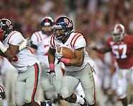 Ole Miss running back Brandon Bolden (34) runs the ball at Bryant-Denny Stadium in Tuscaloosa, Ala.  on Saturday, October 16, 2010. Alabama won 23-10.