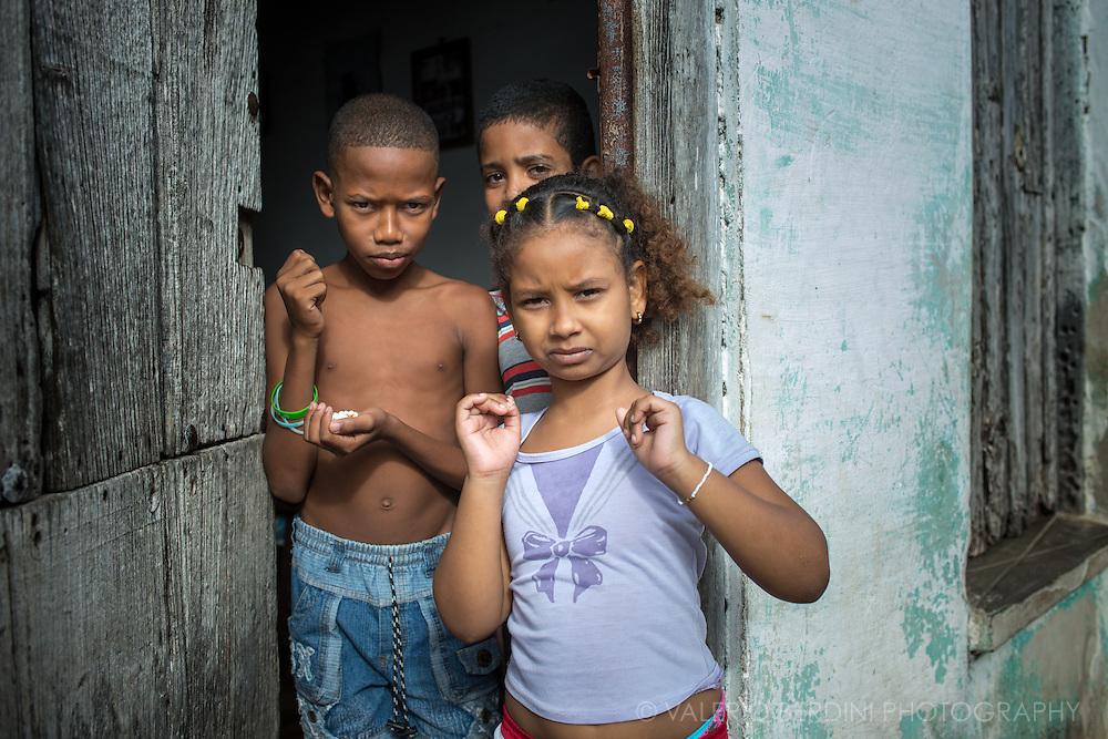 Three children in their doorstep in Remedios, a little village in central Cuba, few miles north of Santa Clara.