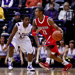 November 30, 2010; Baton Rouge, LA, USA;  Houston Cougars guard Darian Thibodeaux (11) drives past LSU Tigers forward Jalen Courtney (14) during the first half at the Pete Maravich Assembly Center.  Mandatory Credit: Derick E. Hingle