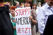 Frankfurt am Main | 30 Aug 2014<br /> <br /> Am Samstag (30.08.2014) demonstrierten &uuml;ber 200 Aktivisten aus dem Umfeld der Partei &quot;Die Linke&quot; und anderen linken und linksradikalen Zusammenh&auml;ngen gegen Krieg und f&uuml;r Frieden. Einige ukrainische Nationalisten und Aktivisten der dubiosen Montagsmahnwache in Frankfurt hatten sich unter die Friedensdemonstranten gemischt.<br /> Hier: Eine Aktivistin auf der Hauptwache mit einem Plakat mit der Aufschrift &quot;Stoppt Amerika Jetzt&quot;.<br /> <br /> &copy;peter-juelich.com<br /> <br /> [No Model Release | No Property Release]