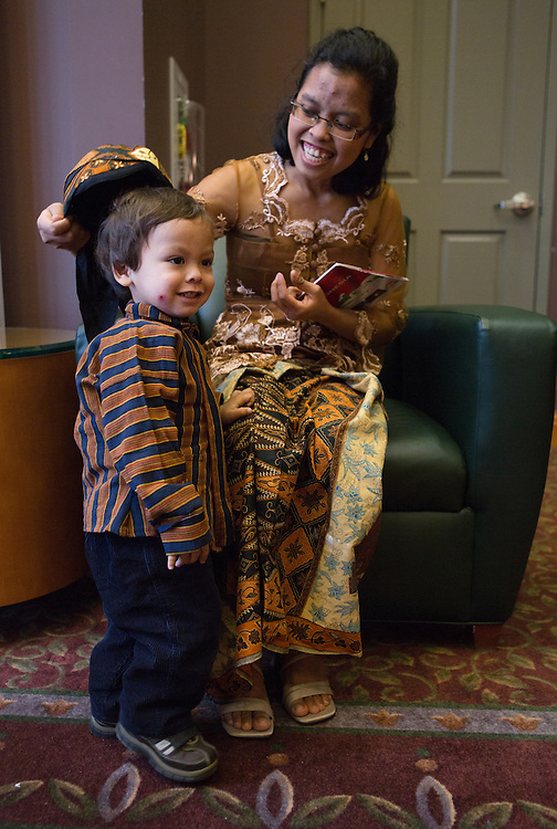 Antonina Suryantari tries to get her son, Ian Suryantoro, 1, to wear his hat during Indonesian Night on Jan. 31, 2014, in Athens. Photo by Lauren Pond