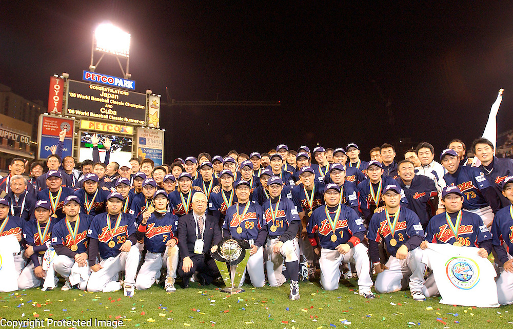 Team Japan poses with the Championship Trophy after beating Team Cuba 10-6 in Final action of the World Baseball Classic at PETCO Park, San Diego, CA.