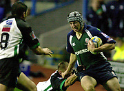 14/12/2003 - Photo  Peter Spurrier.2003/04 Parker Pen Challenge  Cup: London Irish vs Montauban.Exiles Declan Danaher, cuts inside, as the Montauban, defenders tackle.   [Mandatory Credit, Peter Spurier/ Intersport Images].