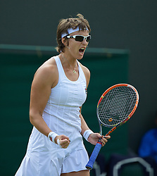 LONDON, ENGLAND - Tuesday, July 1, 2014: Yaroslava Shvedova (KAZ) celebrates winning the second set during the Ladies' Singles 4th Round match on day eight of the Wimbledon Lawn Tennis Championships at the All England Lawn Tennis and Croquet Club. (Pic by David Rawcliffe/Propaganda)