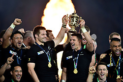 Richie McCaw and Dan Carter of New Zealand lift the Webb Ellis Cup in celebration - Mandatory byline: Patrick Khachfe/JMP - 07966 386802 - 31/10/2015 - RUGBY UNION - Twickenham Stadium - London, England - New Zealand v Australia - Rugby World Cup 2015 Final.