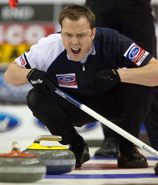 Scottish skip Tom Brewster encourages his sweepers during the gold medal game against Canada at the Ford World Men's Curling Championships in Regina, Saskatchewan, April 10, 2011.<br /> AFP PHOTO/Geoff Robins