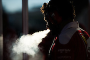 October 22, 2016: United States Grand Prix. Ferrari mechanic smokes in the morning