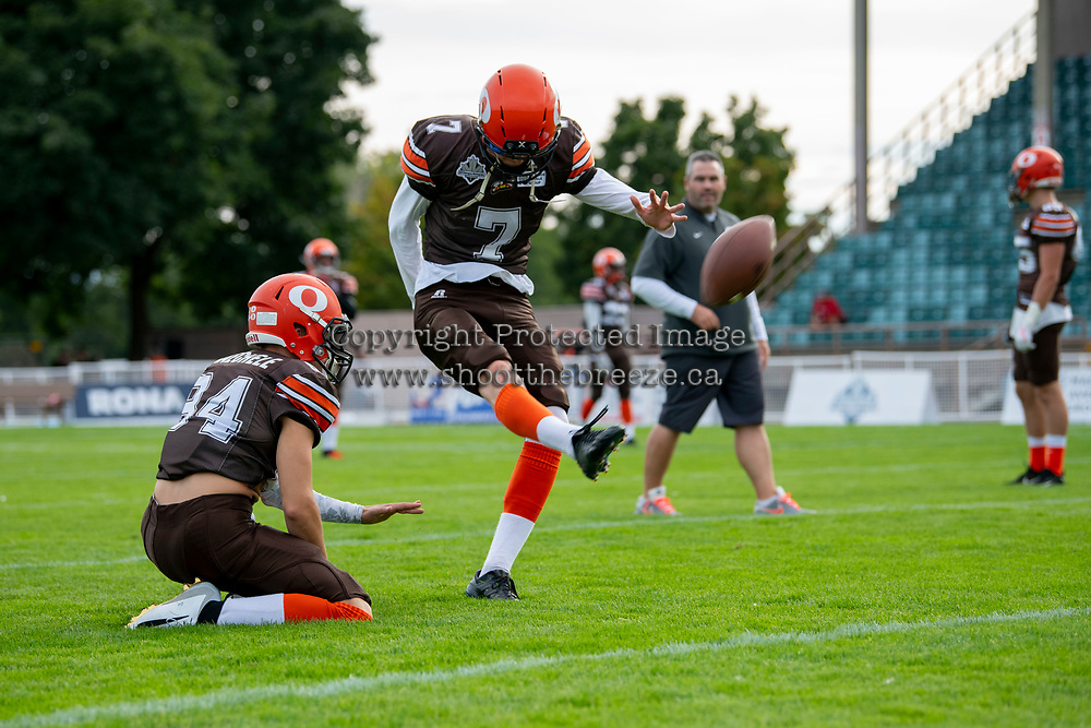 KELOWNA, BC - AUGUST 17:  Javen Kaechele #84 holds the ball for kicker Isaac Wegner #7 of Okanagan Sun during warm up against the Westshore Rebels at the Apple Bowl on August 17, 2019 in Kelowna, Canada. (Photo by Marissa Baecker/Shoot the Breeze)