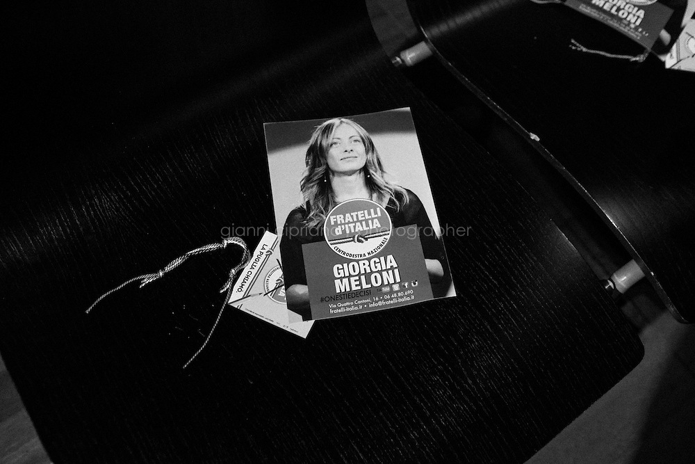 """ROME, ITALY - 6 FEBRUARY 2013: Giorgia Meloni (36), founder and leader of the centre-right party """"Fratelli d'Italia"""" (Brothers of Italy) together with Guido Crosetto and Ignazio La Russa, rallies at the Office Cantelmo in Lecce, Italy, during her campaign in Apulia on February 6 2013.<br /> A general election to determine the 630 members of the Chamber of Deputies and the 315 elective members of the Senate, the two houses of the Italian parliament, will take place on 24–25 February 2013. The main candidates running for Prime Minister are Pierluigi Bersani (leader of the centre-left coalition """"Italy. Common Good""""), former PM Mario Monti (leader of the centrist coalition """"With Monti for Italy"""") and former PM Silvio Berlusconi (leader of the centre-right coalition).<br /> <br /> ###<br /> <br /> ROMA, ITALIA - 6 FEBBRAIO 2013: Giorgia Meloni (36 anni), fondatrice e leader di """"Fratelli d'Italia"""" insieme a Guido Crosetto e Ignazio La Russa,  Giorgia Meloni (36), fa un comizio alle Officine Cantelmo a Lecce durante la sue campagna electoral in Puglia il 6 fennraio 2013.<br /> Le elezioni politiche italiane del 2013 per il rinnovo dei due rami del Parlamento italiano – la Camera dei deputati e il Senato della Repubblica – si terranno domenica 24 e lunedì 25 febbraio 2013 a seguito dello scioglimento anticipato delle Camere avvenuto il 22 dicembre 2012, quattro mesi prima della conclusione naturale della XVI Legislatura. I principali candidate per la Presidenza del Consiglio sono Pierluigi Bersani (leader della coalizione di centro-sinistra """"Italia. Bene Comune""""), il premier uscente Mario Monti (leader della coalizione di centro """"Con Monti per l'Italia"""") e l'ex-premier Silvio Berlusconi (leader della coalizione di centro-destra).LECCE, ITALY - 6 FEBRUARY 2013: Giorgia Meloni (36), founder and leader of the centre-right party """"Fratelli d'Italia"""" (Brothers of Italy) together with Guido Crosetto and Ignazio La Russa, rallies at the Office Cantelmo in Lecce, Italy, during her c"""