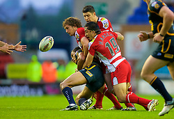 Wigan, England - Thursday, July 12, 2007: All eyes on the ball as Wigan Warriors players tackle Leeds Rhinos' Clinton Toopi fumbles the ball during the Super League match at the JJB Stadium. (Photo by David Rawcliffe/Propaganda)