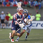Kevin Buchanan #27 of the Boston Cannons controls the ball during the game at Harvard Stadium on May 17, 2014 in Boston, Massachuttes. (Photo by Elan Kawesch)