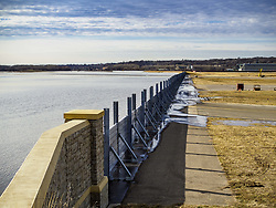 March 29, 2019 - St. Paul, Minnesota, U.S - A temporary flood wall holds back the Mississippi River at the St. Paul Downtown Airport. One runway at the airport is closed because of the potential for flooding and the height of the flood wall. The Mississippi River through the Twin Cities has already hit flood stage. Several roads and parks in St Paul are already closed in anticipation of higher flood levels. Weather forecasters and hydrologists have backed off a little on earlier predictions of severe flooding because the snow melt has been slower than expected. (Credit Image: © Jack Kurtz/ZUMA Wire)