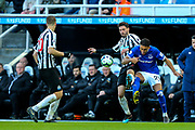 Fabian Schar (#5) of Newcastle United and Dominic Calvert-Lewin (#29) of Everton contest the ball during the Premier League match between Newcastle United and Everton at St. James's Park, Newcastle, England on 9 March 2019.