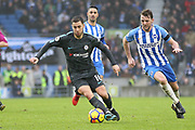 Chelsea Midfielder Eden Hazard battles with Brighton and Hove Albion midfielder Dale Stephens (6) during the Premier League match between Brighton and Hove Albion and Chelsea at the American Express Community Stadium, Brighton and Hove, England on 20 January 2018. Photo by Phil Duncan.