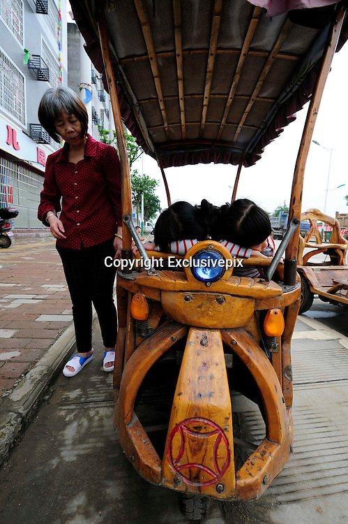 LIUZHOU, CHINA - MAY 19: (CHINA OUT) <br /> <br /> Wooden Three-wheeled Vehicle<br /> <br /> Wei Guirong's second home-made three-wheeled vehicle is seen on May 19, 2014 in Liuzhou, Guangxi Province of China. Wei Guirong, 66, has made three wooden three-wheeled vehicles for grandchildren, and the vehicles are made entirely from wood, apart from the engine, wheels and some electronic parts. He was in charge of maintaining agricultural machinery when he was younger. <br /> &copy;Exclusivepix