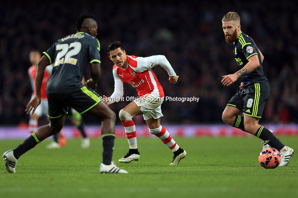 15 February 2015 - The FA Cup Fifth Round - Arsenal v Middlesbrough - Alexis Sanchez of Arsenal in action with Kenneth Omeruo and Adam Clayton of Middlesbrough - Photo: Marc Atkins / Offside.