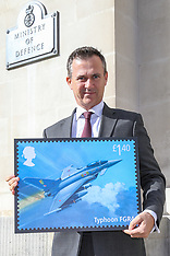2018-03-20 SWNS - Royal Mail - Armed Forces Minister Mark Lancaster with fighter plane stamp design