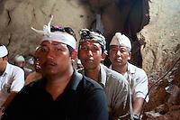 Balinese pilgrims inside the cave temple complex at Goa Giri Putri on Nusa Penida, Bali, Indonesia