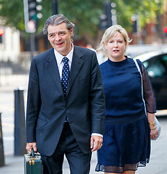 © Licensed to London News Pictures. 10/07/2017. London, UK. RHODRI PHILIPPS, the 4th Viscount St Davids and and his wife SARAH LOUISE BUTCHER arrive at Westminster Magistrates Court in London on Monday, 10 July 2017 as Mr Philipps is accused of writing a threatening message about Gina Miller just four days after she won a High Court appeal against the Government over Brexit in November 2016. Photo credit: Tolga Akmen/LNP