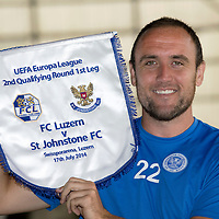 St Johnstone's Lee Croft pictured at McDiarmid Park this morning ahead of Thursday's Europa League qualifier against FC Luzern..Lee is pictured with the pennant that will be given to the Luzern captain...15.07.14<br /> Picture by Graeme Hart.<br /> Copyright Perthshire Picture Agency<br /> Tel: 01738 623350  Mobile: 07990 594431