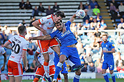 Blackpool defender Ben Heneghan (6) on loan from Sheffield United,  gets in front of Peterborough United defender Ryan Tafazolli (5) to head this one clear during the EFL Sky Bet League 1 match between Peterborough United and Blackpool at The Abax Stadium, Peterborough, England on 29 September 2018.