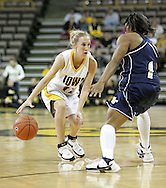 28 NOVEMBER 2007: Iowa guard Kristi Smith (11) is guarded closely by Georgia Tech guard Jacqua Williams (1) in the first half of Georgia Tech's 76-57 win over Iowa in the Big Ten/ACC Challenge at Carver-Hawkeye Arena in Iowa City, Iowa on November 28, 2007.