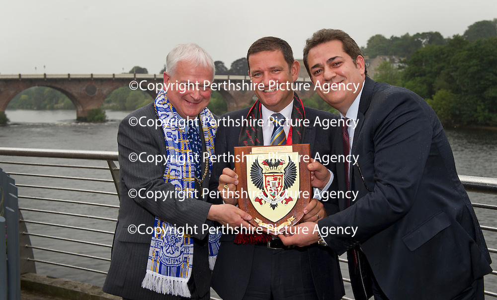 26.7.2012. Eskisehirspor Civic Reception,Perth Council Offices.<br /> Shield presentation, From left, Cllr Ian Miller with St Johnstone Chairman Steve Brown and Eskisehirspor President Halil Unal in Tay Street, Perth.<br /> COPYRIGHT: Perthshire Picture Agency.<br /> Tel. 01738 623350 / 07775 852112.