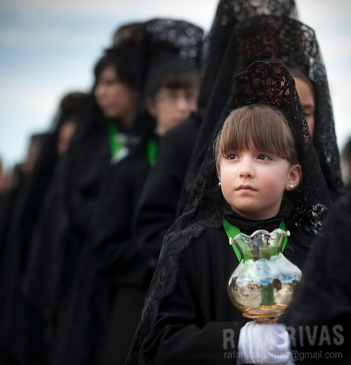 Women and girls march during the Virgen de la Esperanza (Virgin of Hope) procession, on Holy Thursday, April 21, 2011, during the Holy Week of the Northwestern Spanish town of Zamora. Photo Rafa Rivas