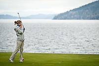 Lake City High's Ashley Eachon watches her tee shot fly toward the green of third hole Thursday which is next to a cliff over Lake Coeur d'Alene during the Coeur d'Alene Resort Shootout.