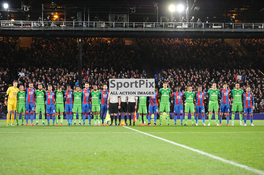 The Crystal Palace and Sunderland players honor the victims of the Paris attacks before the Crystal Palaces clash with Sunderland in the Barclays Premier League at Selhurst Park