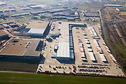 Nederland, Gelderland, Duiven, 11-02-2008; distributiecentrum van TNT (voorheen PTT Post) op het bedrijventerrein Nieuwgraaf, boven in beeld autosnelweg A12; vrachtwagens, opleggers, trailers, distributie, logistiek, vervoer, privatisering, export, bedrijven terrein, industrieterrein, parkeerterrein, parkeren, wegvervoer, vrachtvervoer, vrachtauto, roadhub, hub, overslag, distributie, sorteren, post, vracht, pakket, PTT, depot, pakje, pakjes, logistisc, logistiek..luchtfoto (toeslag); aerial photo (additional fee required); .foto Siebe Swart / photo Siebe Swart