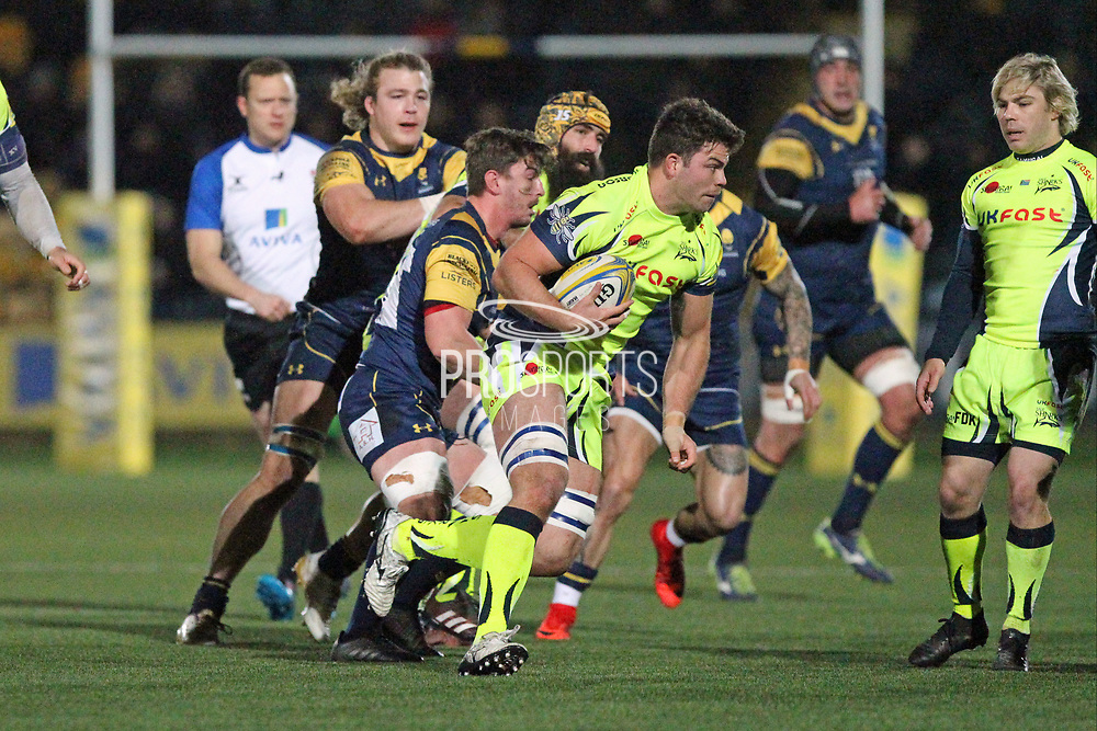 Josh Strauss is tackled during the Aviva Premiership match between Worcester Warriors and Sale Sharks at Sixways Stadium, Worcester, United Kingdom on 1 December 2017. Photo by Daniel Youngs.