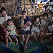 Ethnic Karen wait to see a doctor at a makeshift neo-natal clinic inside the Mae Hla refugee camp along the Thai-Burma border.  More than 100,000 Karen from Burma are currently living in refugee camps in Thailand.