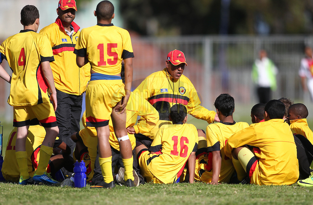 Engen Santos coach talks to his boys at half time during the Final on the final day of the Engen Knock Out Challenge held at Stephen Reagan Sports Ground, Mitchells Plain in Cape Town on the 30th September 2012..Photo by Shaun Roy/ SPORTZPICS..