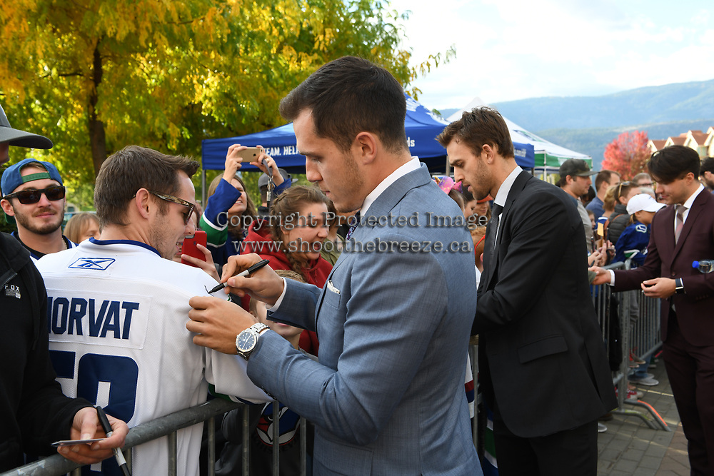 KELOWNA, BC - SEPTEMBER 29:  Brandon Sutter #20 and Bo Horvat #53 of the Vancouver Canucks sign autographs prior to the final pre-season game against the Arizona Coyotes at Prospera Place on September 29, 2018 in Kelowna, Canada. (Photo by Marissa Baecker/NHLI via Getty Images)  *** Local Caption *** Bo Horvat; Brandon Sutter