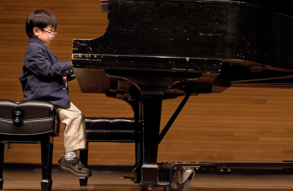 Seungju Baek, five, plays in his first ever public performance at O.U.'s School of Music on Friday, 5/11/07, during the Athens Community Music School's Spring Recital.