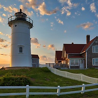 New England photography of Nobska Lighthouse at sunset. This iconic Massachusetts lighthouse is located near Woods Hole Village in Falmouth, MA on Cape Cod.<br />