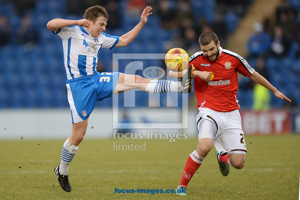 Tom Lapslie of Colchester United does battle with Greg Leigh of Crewe Alexandra during the Sky Bet League 1 match between Colchester United and Crewe Alexandra at the Weston Homes Community Stadium, Colchester<br /> Picture by Richard Blaxall/Focus Images Ltd +44 7853 364624<br /> 07/02/2015