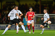 Swindon Town Defender, Raphael Rossi Branco take on the Northampton Town defence during the EFL Sky Bet League 1 match between Swindon Town and Northampton Town at the County Ground, Swindon, England on 27 September 2016. Photo by Adam Rivers.