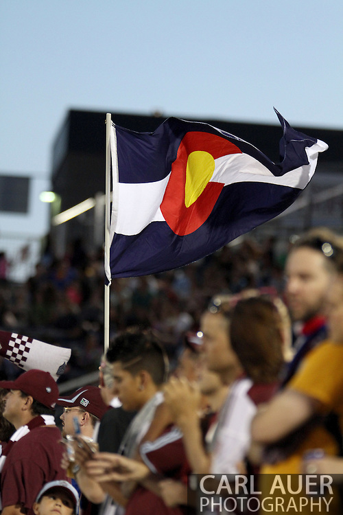 July 17th, 2013 - A fan waves a Colorado state flag after the Rapids take a 2-1 lead in the second half of the Major League Soccer match between the New England Revolution and the Colorado Rapids at Dick's Sporting Goods Park in Commerce City, CO
